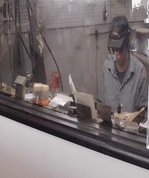 Expert Jeweler performing repair work